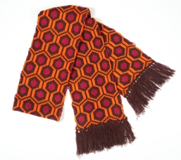 Mondo 237: Knit Scarf - 100% acrylic heavy knit scarf. Six foot in length with dark brown tassels. One size. $50